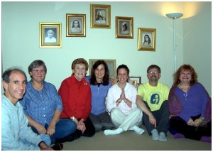 members of berkeley ananda smiling in meditation room